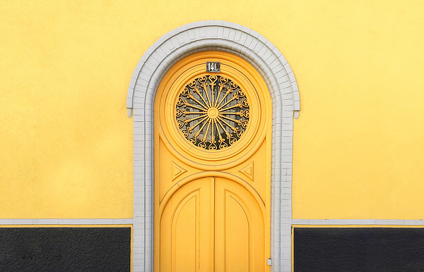 Ornate yellow door and yellow wall