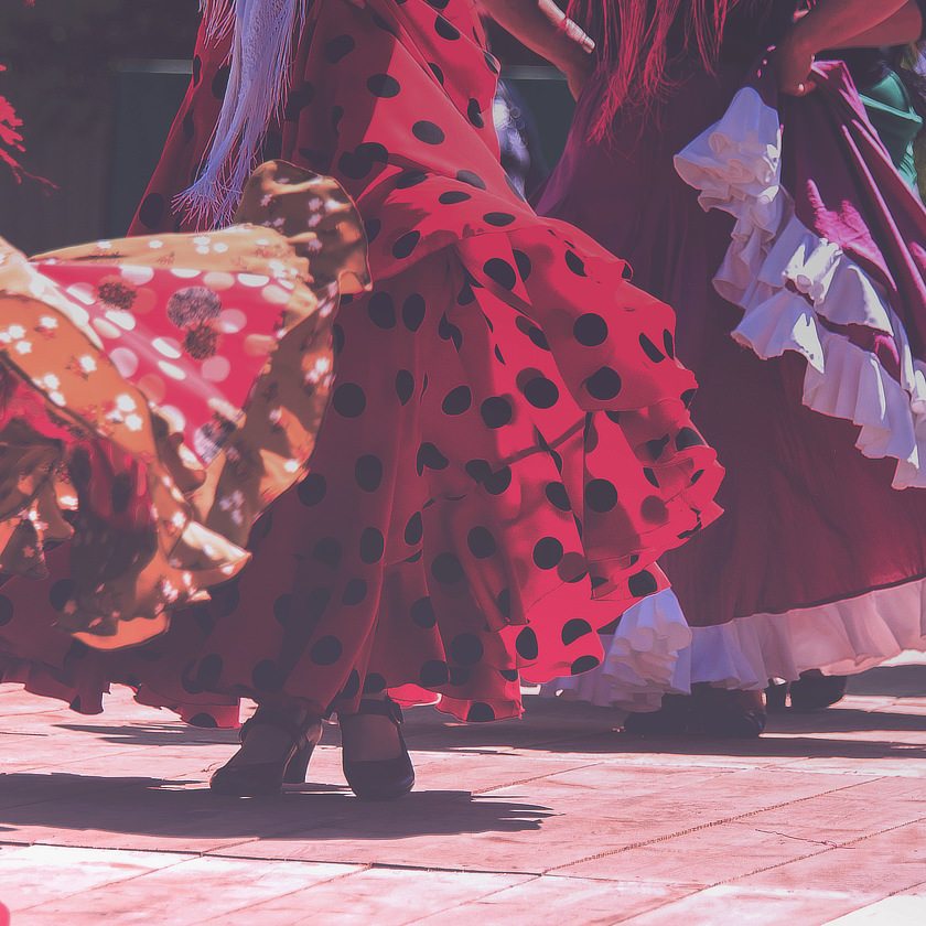 Photo: Crop of women dancing in flamenco-style dresses